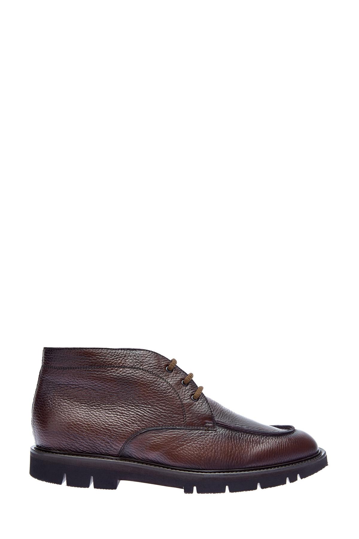 Высокие ботинки с мехом из крупнозернистой кожи фото