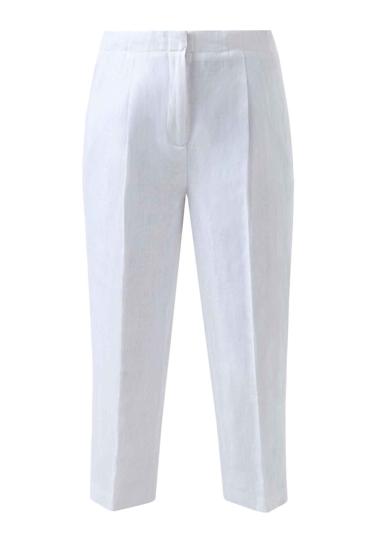 Укороченные брюки изо льна с заложенными складками фото